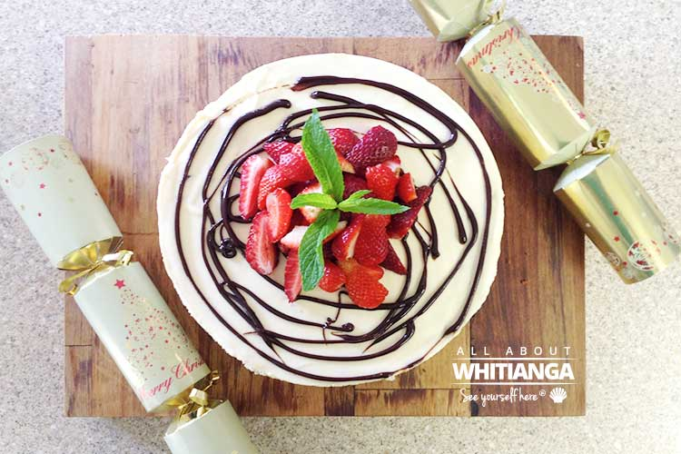 Lemon and Pomegranate Torte topped with Hershey's Chocolate Sauce and Strawberries